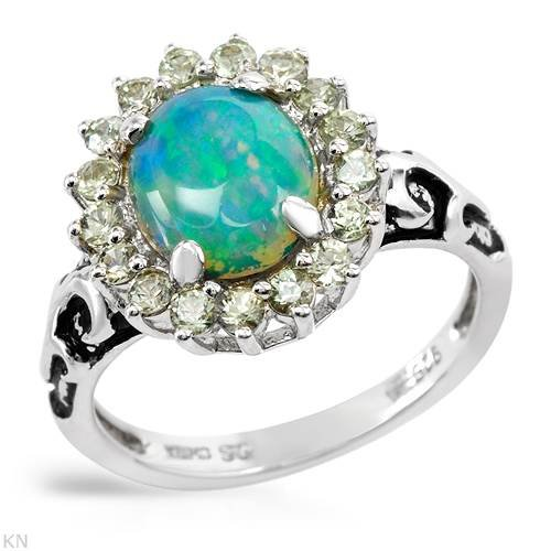 Sterling Silver Opal and 0.65 CTW Sapphire Ladies Ring. Ring Size 7. Total Item weight 3.8 g.