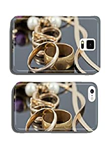 buy Gold Wedding Rings, Earrings And Chains On A Reflective Surface Cell Phone Cover Case Samsung S5