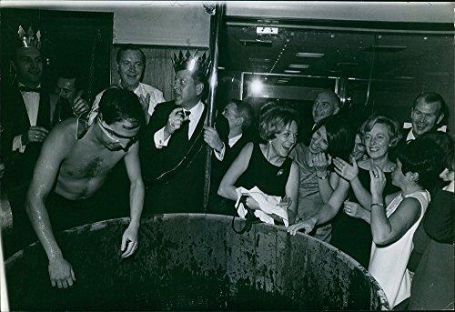 vintage-photo-of-shirtless-man-having-blindfold-on-eyes-people-gathered-around-and-laughing-1966eel-