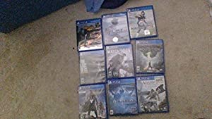 Like- Playstation 4 w/ 9 Games (In Picture)