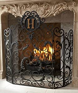 Monogrammed Curved Old World Iron Fireplace