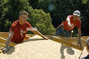 Photo US Navy (USN) Hospital Corpsman Third Class (HM3) Jonathan Grooms (left) assigned to the USN Nimitz Class Aircraft Carrier USS JOHN F. KENNEDY (CV 67), and Mr. Paul Finley, Beaches Habitat Construction Manager, work together on a roof during a community relations project for the local Habitat for Humanity chapter in Atlantic Beach, Florida (FL), 05/19/2006