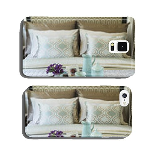 Decorative tray with book,tea set and flower on the bed cell phone cover case iPhone5
