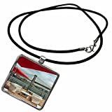 white table, red umbrella under bridge Necklace With Pendant is a great gift item and a fun way to express your personality, while being fashionable. Features a rectangular pendant, crafted of Zinc Alloy, approximately 1 by 1 inch. Silver ton...
