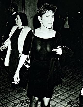 Carrie Fisher smoking a cigarette (or weed)