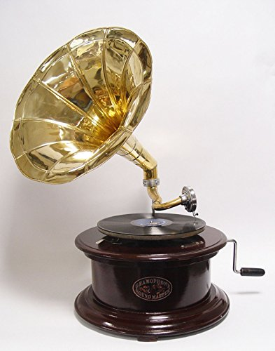Grammophon goldener Verstärker runder dunkelbrauner Unterbau alter Plattenspieler