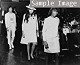 1967 Three African American teenage females modeling clothing for the