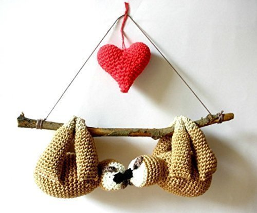 Stuffed-sloths-couple-on-a-branch-with-red-heart-cute-gift-crochet-sloths