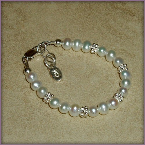 Victoria Sterling Silver Childrens Girls Bracelet Jewelry NEW! Luxurious sterling silver bracelet with beautiful soft white freshwater pearls accented with shimmering silver daisies. A keepsake she will cherish forever! Size Medium 1-5 Years