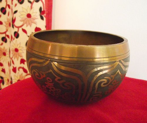 Tibetan Singing Bowl; with Grey-Black Coating on Outer/Inner Surface; Engraved with 'Om Mani Padme' Symbols on Outer  &  Inner Surfaces; 5.5in Diameter; 675grams weight. Plays a lovely clear 'D' note associated with the Sacral Centre; Playing Stick Included - sold by Spiritual Gifts. Usually dispatched within 2 working days.