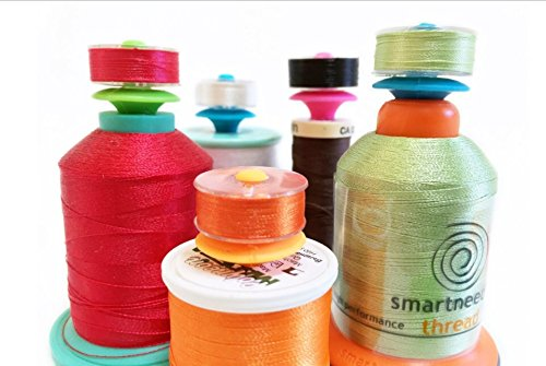 BOBBIN HOLDER...'BOBBINI' (12 Pieces). Storage Bobbins on Top of Thread Spools. Fits Type L, Class A(15) and Class M Bobbins and works on most sewing thread spools. By Smartneedle.