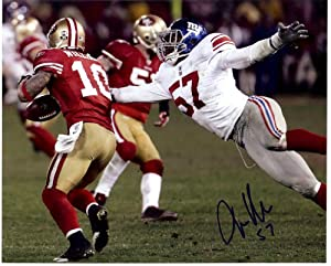 New York Giants Jacquiqn Williams strips the ball during the NFC championship game. Autographed 8x10 photo.
