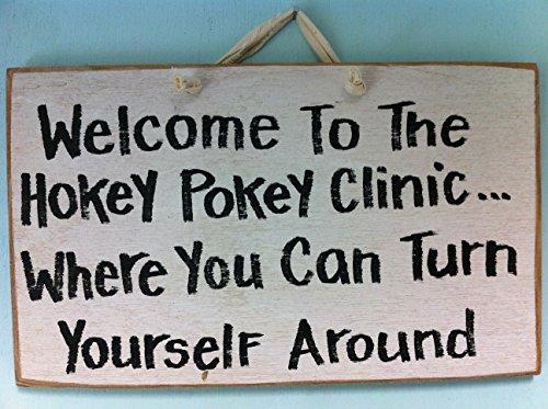 welcome-to-hokey-pokey-clinic-where-you-turn-yourself-around-sign