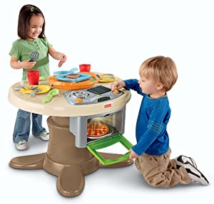 Fisher price servin 39 surprises kitchen table for Toy kitchen table