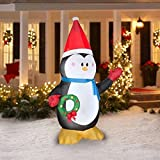 CHRISTMAS INFLATABLE 7' PENGUIN W/ SANTA HAT HOLDING WREATH