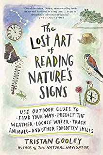 Book Cover: The Lost Art of Reading Nature's Signs: Use Outdoor Clues to Find Your Way, Predict the Weather, Locate Water, Track Animalsand Other Forgotten Skills