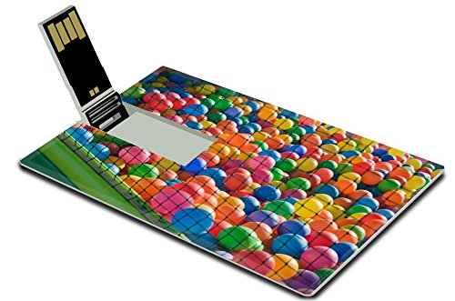 MSD 32GB USB Flash Drive 2.0 Memory Stick Credit Card Size 28441203 Photo of a playground for children full of colorful plastic balls behind the net
