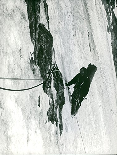 Man climbing with rope.