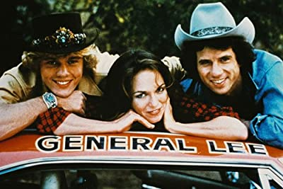 Catherine Bach, John Schneider and Tom Wopat in The Dukes of Hazzard 24x36 Poster on top of General Lee