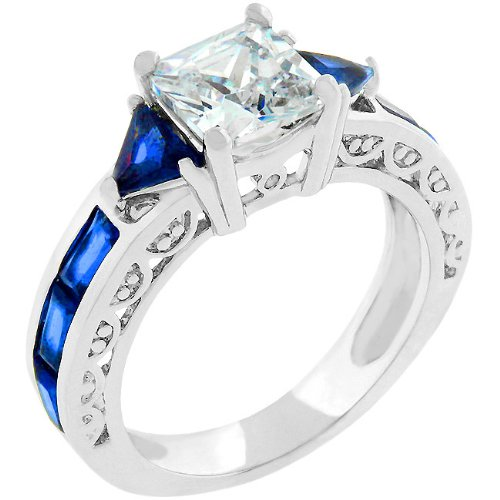 September Birth Stone Blue Sapphire Princess Queen Royalty Regal Engagement Ring White Gold Rhodium Plated with Radiant and Trillion Cut Sapphire Crystals and Round Cut Clear Crystal Colored April Birth Stone Faux Diamond CZ Cubic Zirconia Stones Handset Along the Shank and Prong Set Princess Cut Center Stone in Silvertone 15 mm x 7 mm x 7 mm SIZE WOMENS 5