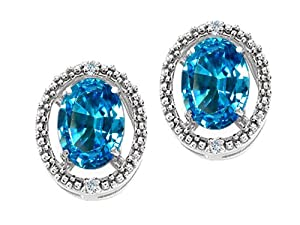Tommaso Design(tm) Oval 8x6mm Genuine Blue Topaz and Diamond Earrings in 14 kt Yellow Gold