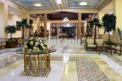 """Wallmonkeys Peel and Stick Wall Decals - Hall in Hotel with Marble Floor and Flowers on the Table - 24""""W x 16""""H Removable Graphic"""