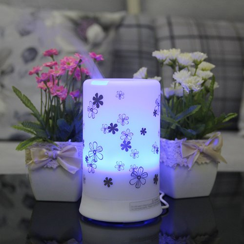 White  Ultrasonic Aroma Diffuser and Humidifier with Chrysanthemum Pattern, 4 Timer Settings and 7 Color Changes