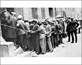 Photographic Print of DEPRESSION HARLEM, 1931. Men lined up outside an unemployment office in from Granger Art on Demand