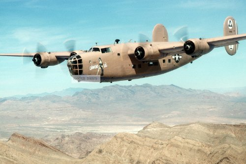 Photo An air-to-air left front view of a B-24 Liberator aircraft flying in an air show held during the Air Force Association's
