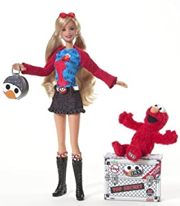 Amazon.com : Barbie Loves T.M.X. Elmo Doll : Fashion Dolls : Toys