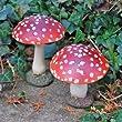 Paire de champignons en r�sine rouge pour d�corer le jardin.