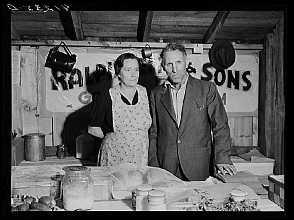 Mr. and Mrs. Ralph Reitz at Tri-County Farmers Co-op Market, 1940