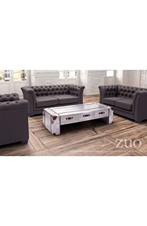 Kant Wide Coffee Table Distressed Aluminum. The Kant distressed aluminum wide coffee table comes with 3 small drawers on one side. Details include leatherette corner swatches adhered by small nailhead details and leather handles. Soft polyester fabric fin