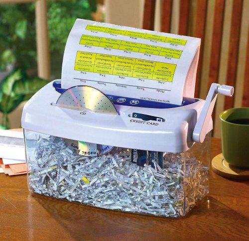 hand in paper shredder