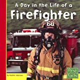 img - for A Day in the Life of a Firefighter (First Facts: Community Helpers at Work) book / textbook / text book