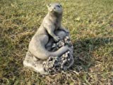 Curled otter s stone garden ornament