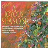 img - for A Joyous Season Featuring Julie Hammerback on Harp: Joy to the World, We Three Kings / I Saw Three Ships, the First Noel, Away in a Manger, Ave Maria, Deck the Halls, Silent Night, O Come O Come Emmanuel / What Child Is This, Laudation, Christmas Medley, Sheep May Safely Graze, It Came Upon a Midnight Clear, Jesu Joy of Man's Desiring, O Holy Night / Rejoice Rejoice book / textbook / text book