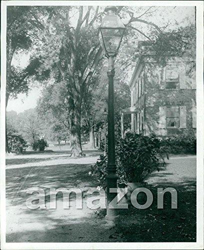 vintage-photo-of-gas-lamp-near-sidewalk-ahp-726