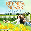 A Baby of Her Own: Dundee, Idaho, Book 1 (       UNABRIDGED) by Brenda Novak Narrated by Carly Robins