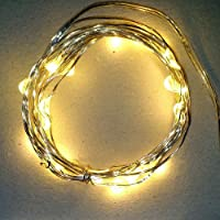 Starry Lights Mini: 20 Micro LEDs Warm White Color on Ultra-thin Silver Wire (6.56Ft / 2M.) - Starry String Lights Battery Operated + On/Off Switch. HOT item as String Bike Lights! Favourite's Girls & Boys Bedroom Hanging Lights. Indoors / Outdoors Garlan