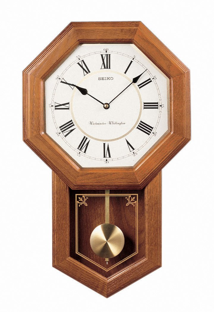 Seiko Brown Oak Schoolhouse Wall Clock: Schoolhouse style clock design in a dark brown solid oak case.