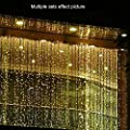 YHCHOO 304LED 3M*3M/9.84ft*9.84ft Window Curtain Lights Fairy Icicle String Lights Party Wedding Christmas Lights for Indoor/Outdoor Home Garden Decorations 110v (Warm White)