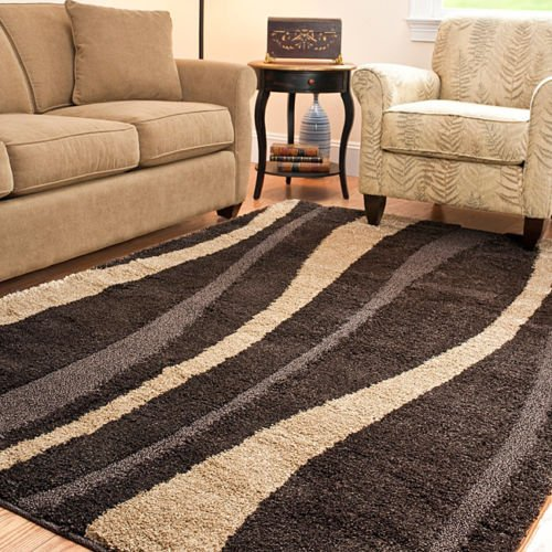 Ultimate Hand Crafted Casual 8' x 10' Dark Brown & Cream Shag Rug. This Power-loomed Shag Rug Offers Luxurious Comfort and Unique Styling with a Raised High-low Pile.