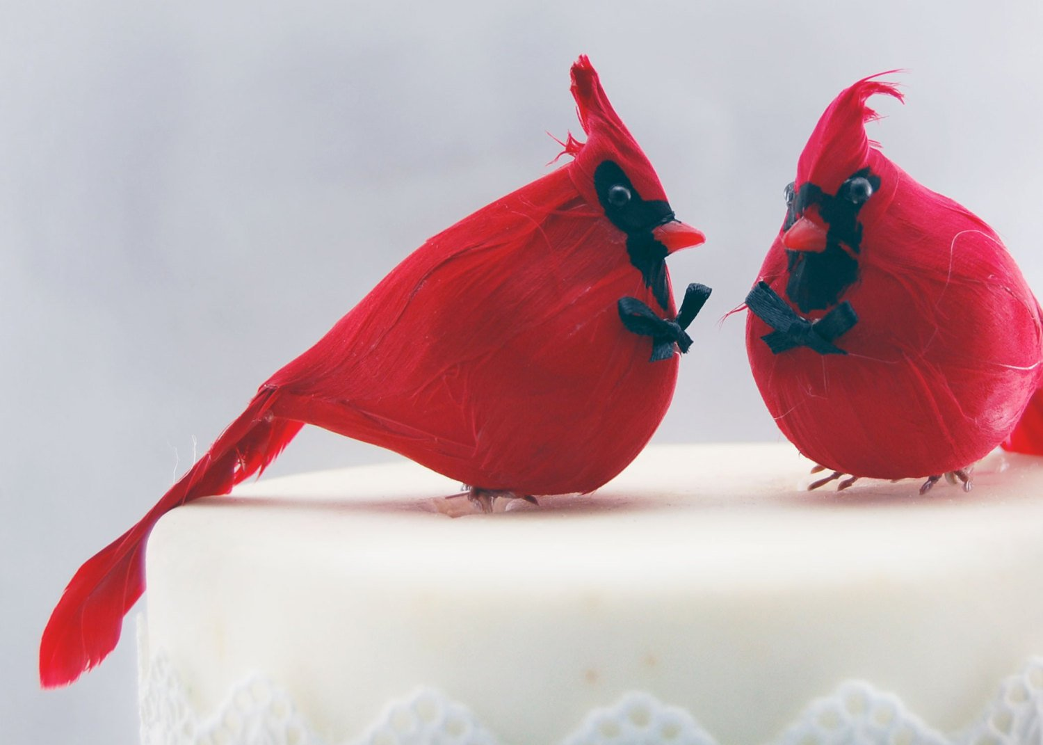 Two cardinals cake toppers