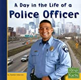 img - for A Day in the Life of a Police Officer (First Facts: Community Helpers at Work) book / textbook / text book