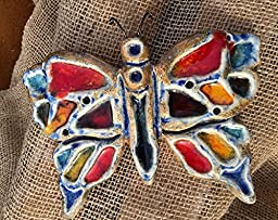 Butterfly in clay and glass