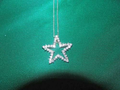 Sterling silver necklace with star embedded with cubic zirconias