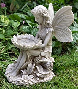 Fairy sitting with sunflower on her knees garden fairies statue garden outdoors - Large garden fairy statues ...