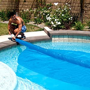 Solar roller freeform pool cover remover - Covering a swimming pool with decking ...