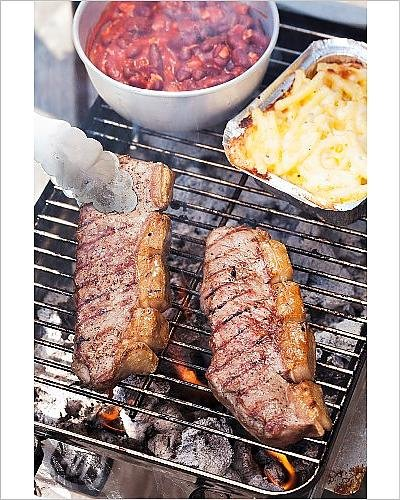 photographic-print-of-beef-steaks-tomato-beans-and-macaroni-and-cheese-on-a-grill